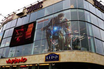 Teippaukset - Trükitud perfokile kampaania reklaamiga maja klaasfassaadile